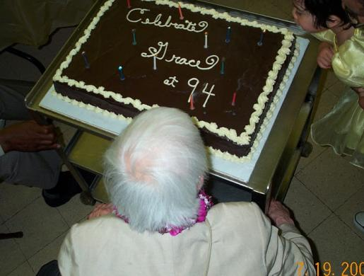 Grace Lee Boggs with birthday cake